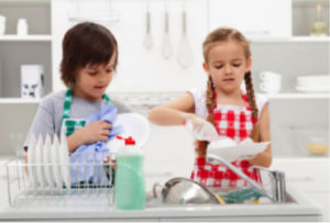 little boy and girl washing dishes